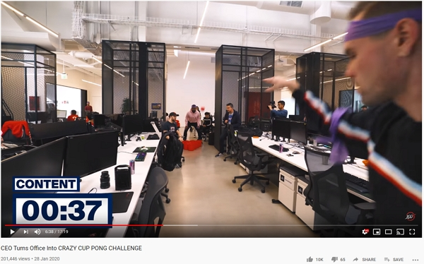 screenshot of a youtube video with offices in the background